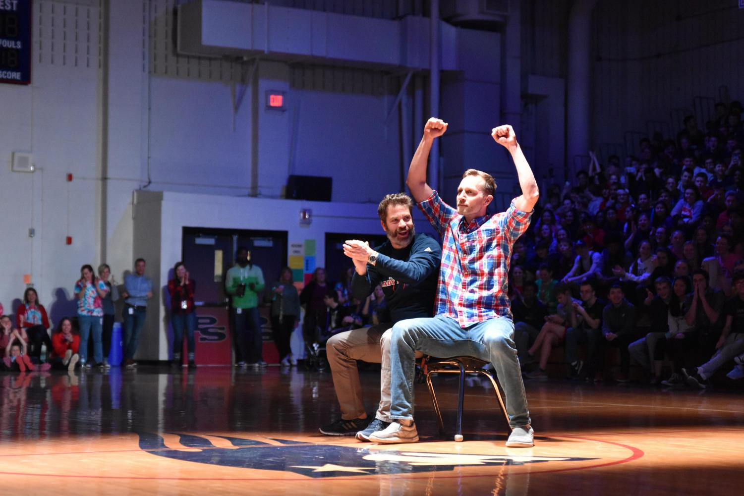 History teachers Mitch Stevens and Thomas Williams win a contest at last year's Renaissance Assembly.