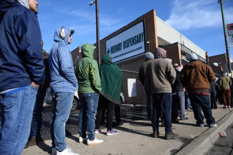 On the second day of legal recreational cannabis sales, a line of people wait outside the Midway Dispensary store, 5648 S. Archer Ave., in Chicago, on Jan. 2, 2020.