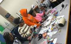Junior Anaya Willis, sophomore Zakiyah Willis, sophomore Hope Doyle,  junior Khaeleana Minton, and sophomore Aris Owens work on crafts in the library during Black History Month.