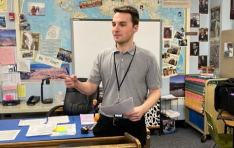 Scott Winfrey helps lead a class while substituting at West High.