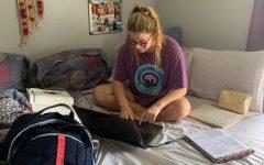 Junior Paige Kehlenbrink works on her e-learning in her bedroom.