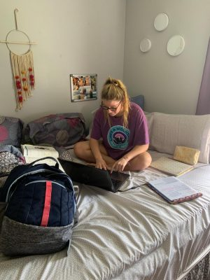 Junior Paige Kehlenbrink works on her e-learning in her bedroom.