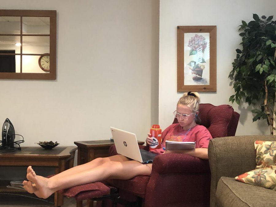 Senior+Lauren+Bles+does+her+online+learning+in+her+living+room+recliner.