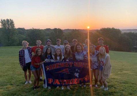 Seniors pose for a picture with the sunrise in the background on the first day of school.