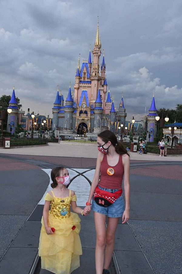 While wearing a mask, freshman Ellie Callahan has fun at Disney World with her niece over the summer.