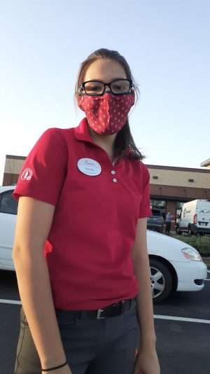 Junior Rachel Jacklin wears a mask during her shift at Chick-fil-A.