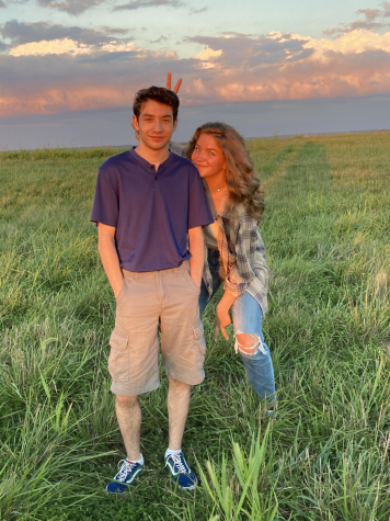 Seniors Aaron Bennett and Emily Paule enjoy the summer sunset together.