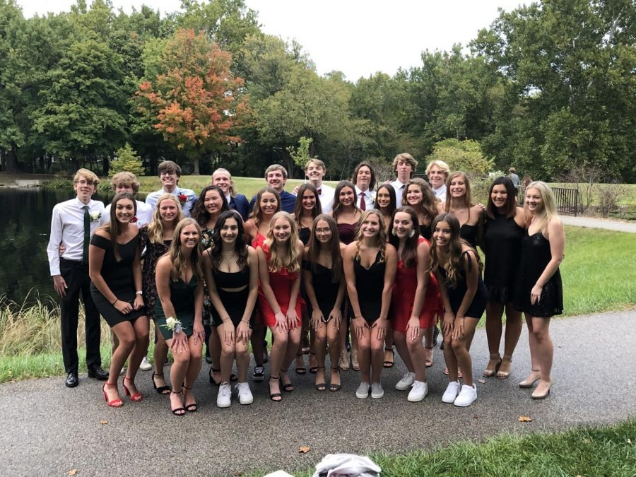 A group of senior friends gets together  at Des Peres park to take a