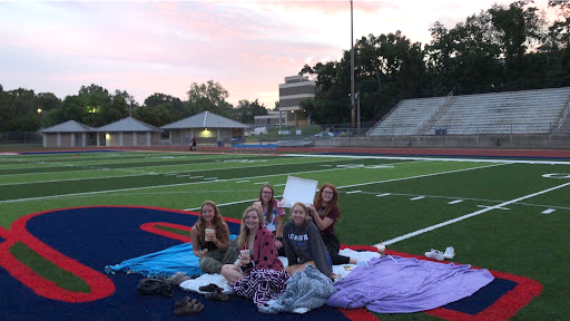 Seniors Sophia Auberry, Jordan Medlock, Anna Kornfeld, Emma Kauffman, and Lindsey Storey celebrate Stephanie Hooker's birthday on the 50 yard line at 5 a.m.