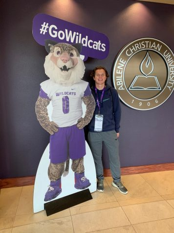 Senior James Stone poses next to the mascot for Abilene Christian University, the college he