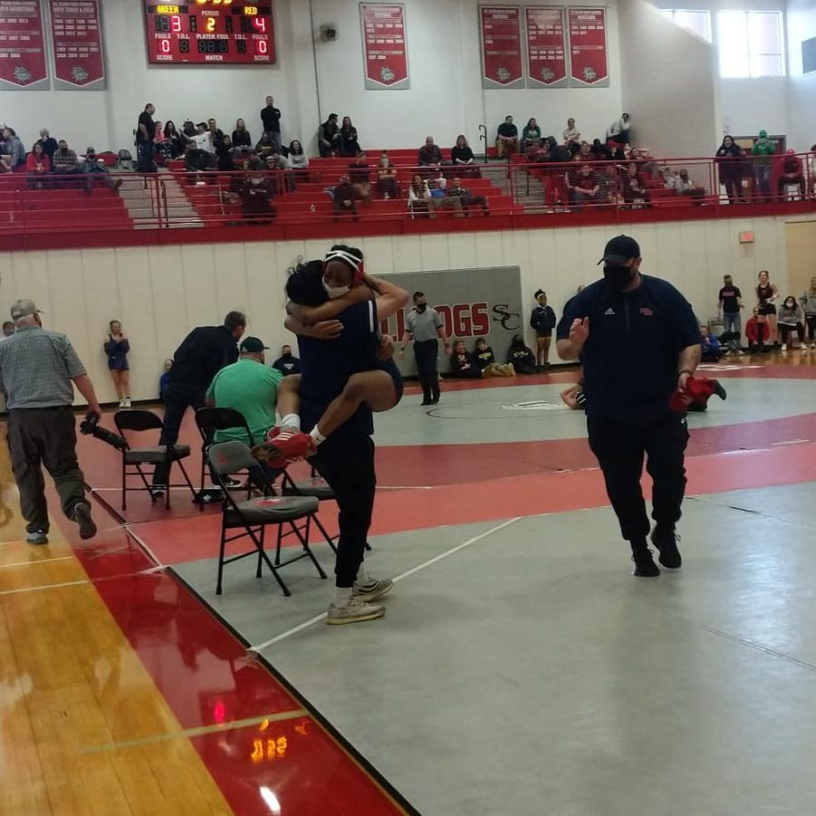 Sophomore Janiah Jones leaps into the arms of a teammate after qualifying for the state tournament.