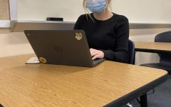Sophomore Sophie Medlock works on her Chromebook in her U.S. History class. Medlock chose the in-person learning option.