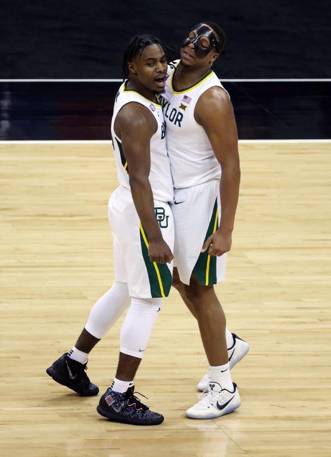 Davion Mitchell #45 of the Baylor Bears celebrates with Mark Vital #11 after making a three-pointer during the quarterfinal game against the Kansas State Wildcats of the Big 12 basketball tournament at the T-Mobile Center on March 11, 2021, in Kansas City, Missouri.