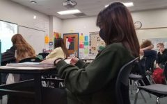 While in her AP U.S. History class, junior Grace Miller uses some free time to study for the upcoming ACT test.