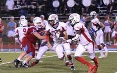Senior quarterback Quinn Candelario runs with the ball as junior running back Derrion Boyd looks for the pitch in the game against Parkway West.