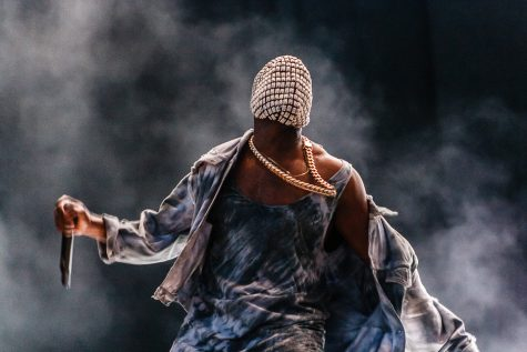 Kanye West performs at a concert.
